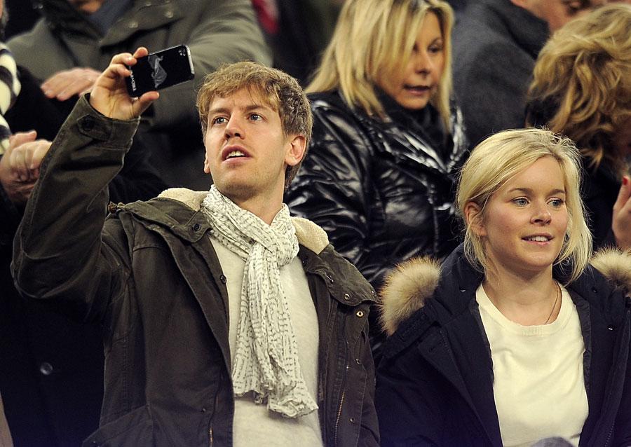 Sebastian Vettel enjoys some company at Camp Nou for Barcelona v Valencia on Sunday night
