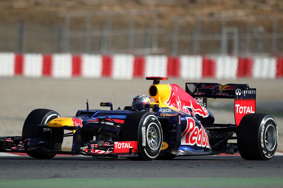 Sebastian Vettel attacks turn three