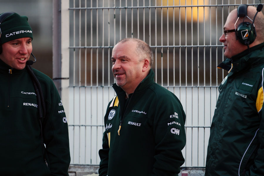 Mike Gascoyne and Caterham engineers in good spirits on Wednesday morning