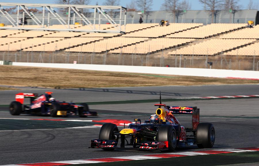 Sebastian Vettel leads Daniel Ricciardo on track