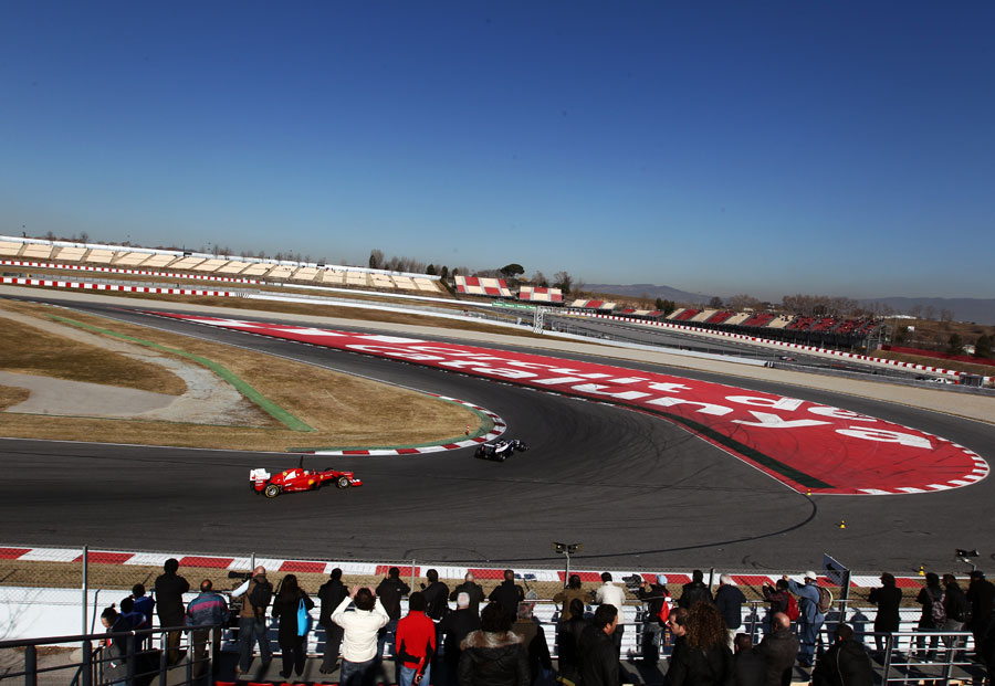 Valtteri Bottas leads Fernando Alonso through turn 10