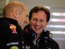 Christian Horner and Adrian Newey enjoy a joke in the Red Bull garage