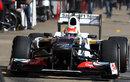 Sergio Perez leaves the Sauber pit box