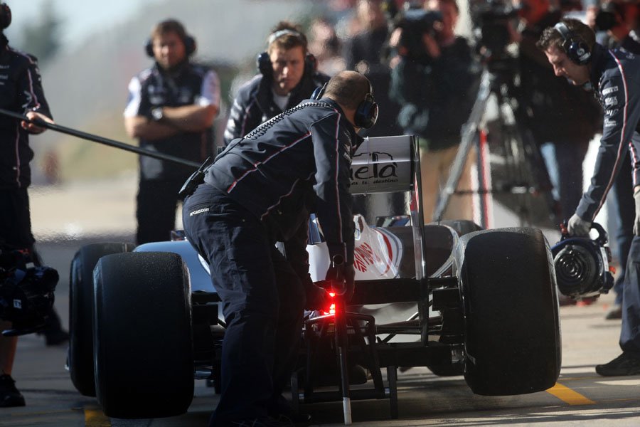 The WIlliams FW34 of Valtteri Bottas is jacked up by the pit crew