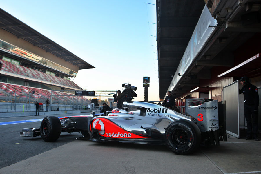 Jenson Button leaves the McLaren garage on hard tyres