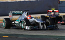 Jean-Eric Vergne looks for a way past as Michael Schumacher runs wide at the chicane