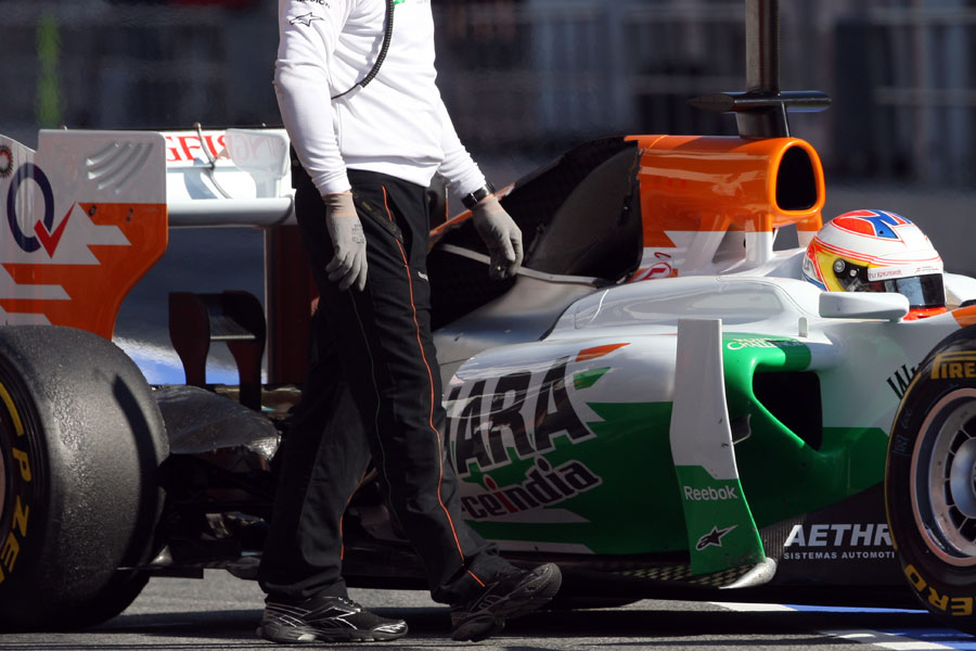 Paul di Resta returns to the pits with part of his engine cover missing, which caused a red flag