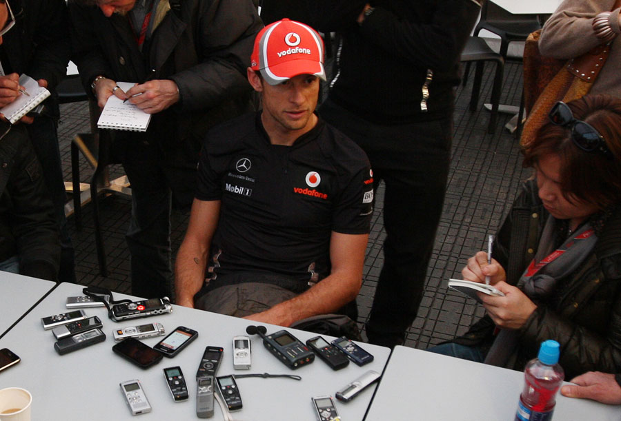 Jenson Button talks to the press after a day's testing