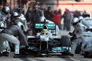 Mercedes complete a tyre change on Nico Rosberg's car