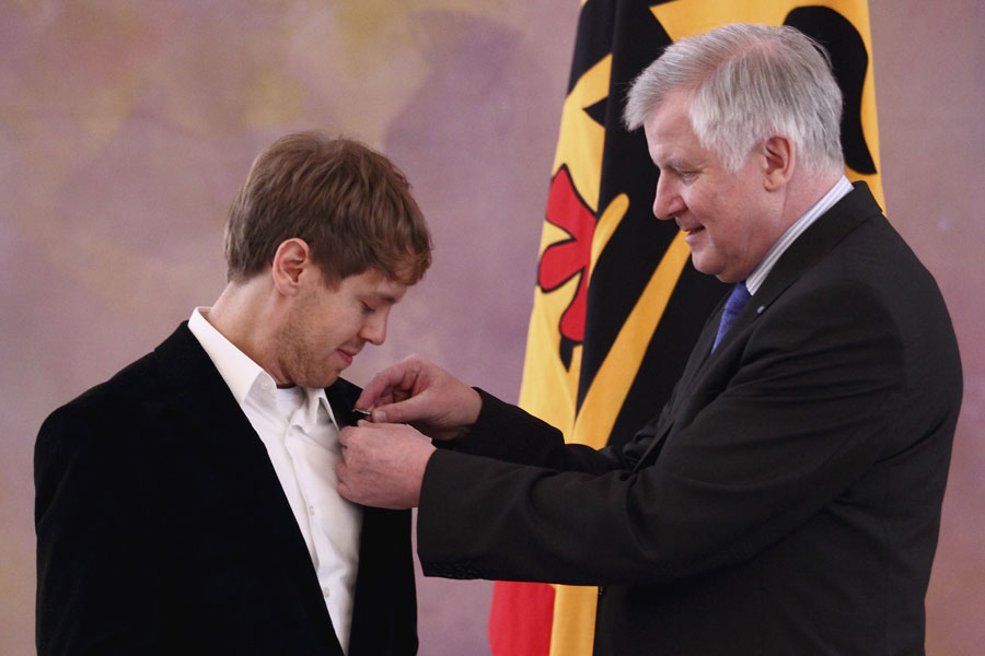Sebastian Vettel receives the silver laurel leaf, Germany's highest sporting award, at the Presidential Bellevue Palace