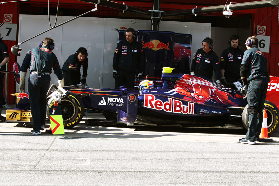 Jean-Eric Vergne hits his marks outside the Toro Rosso garage