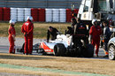 McLaren mechanics arrive at Jenson Button's stricken MP4-27