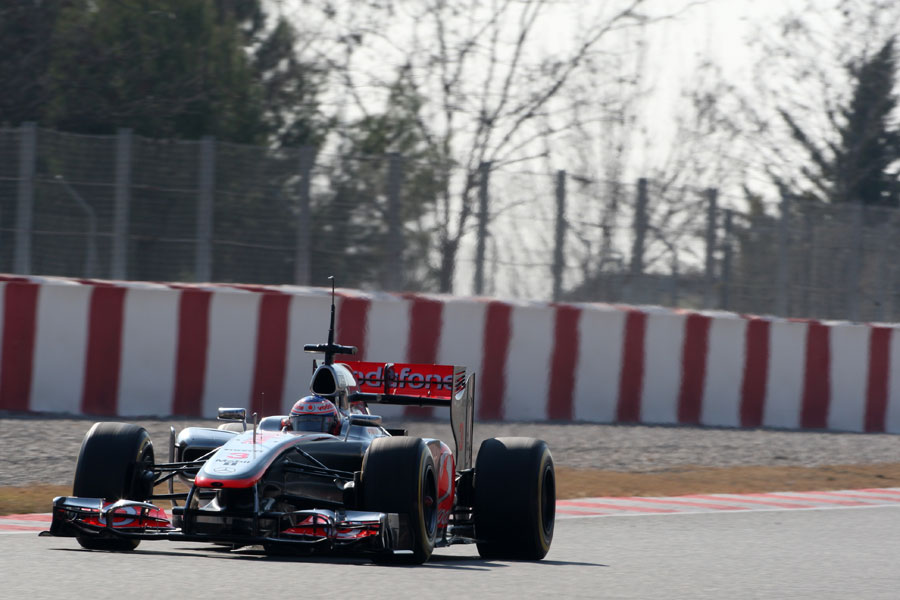 Jenson Button speeds towards turn 10 late in the day