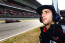 Daniel Ricciardo keeps an eye on the progress of team-mate Jean-Eric Vergne