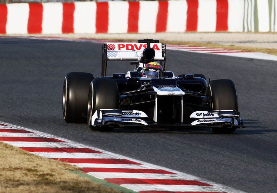 Pastor Maldonado brakes for the chicane