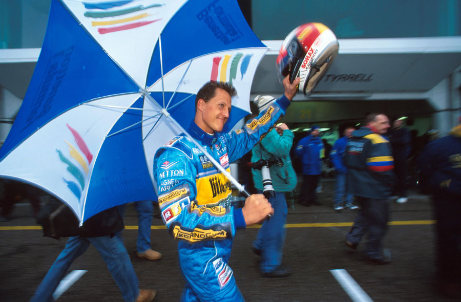 Michael Schumacher salutes the fans after all but sealing his second championship