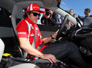 Fernando Alonso familiarises himself with the controls of a Ferrari 458 road car