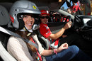 Fernando Alonso gives passenger rides during a promotional day