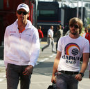 Adrian Sutil and Nick Heidfeld arrive in the paddock