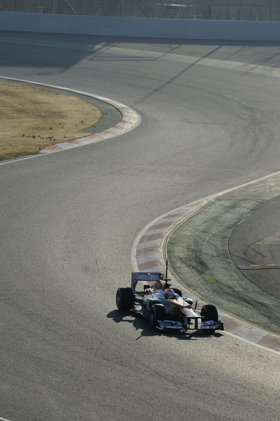 Paul di Resta puts some early-morning miles on the Force India
