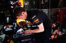 A mechanic works on Mark Webber's Red Bull
