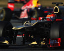 Romain Grosjean leads Mark Webber on track