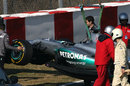 Michael Schumacher's Mercedes gets hoisted onto a recovery truck