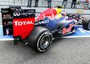 Mark Webber leaves the garage in the heavily-revised Red Bull