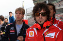 Sebastian Vettel and Fernando Alonso on the pit wall