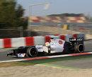 Sergio Perez attacks the final corner of the lap