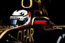 Kimi Raikkonen leaves the Lotus garage