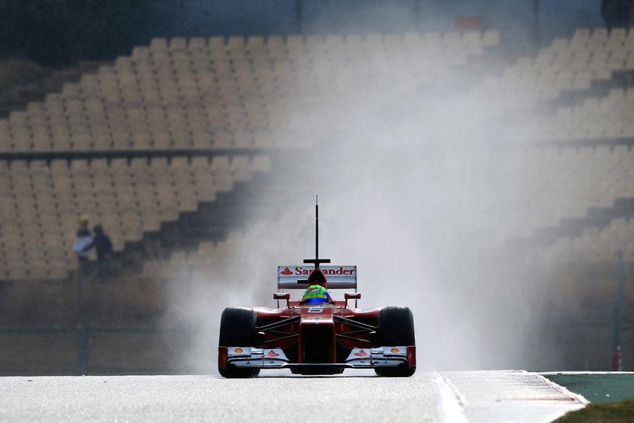 Felipe Massa's Ferrari leaves a trail of spray in its wake
