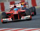 Fernando Alonso's Ferrari leads Sebastian Vettel's Red Bull