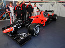 The new Marussia MR01 with its team and drivers