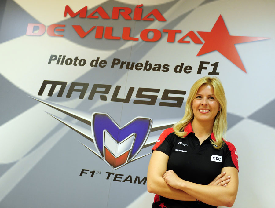 Marrusia test driver Maria de Villota poses for photos at a press conference