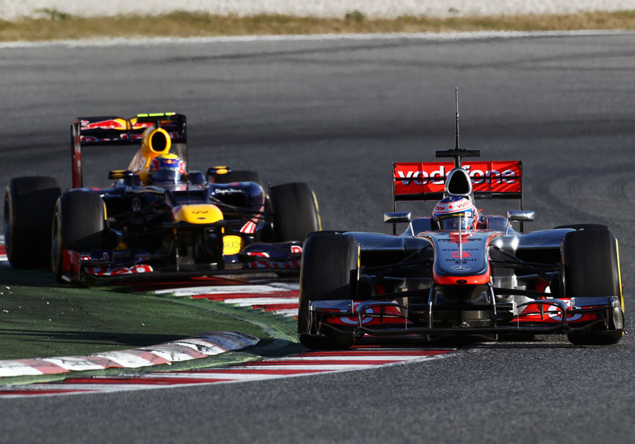 Jenson Button leads Mark Webber on track