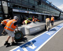 A Mercedes chassis arrives in the pit lane