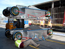 Workmen unload Mercedes' two chassis in the Albert Park pit lane