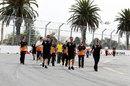 Team members walk the Albert Park track on Wednesday