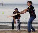 Sebastian Vettel and Mark Webber play cricket on St Kilda Beach