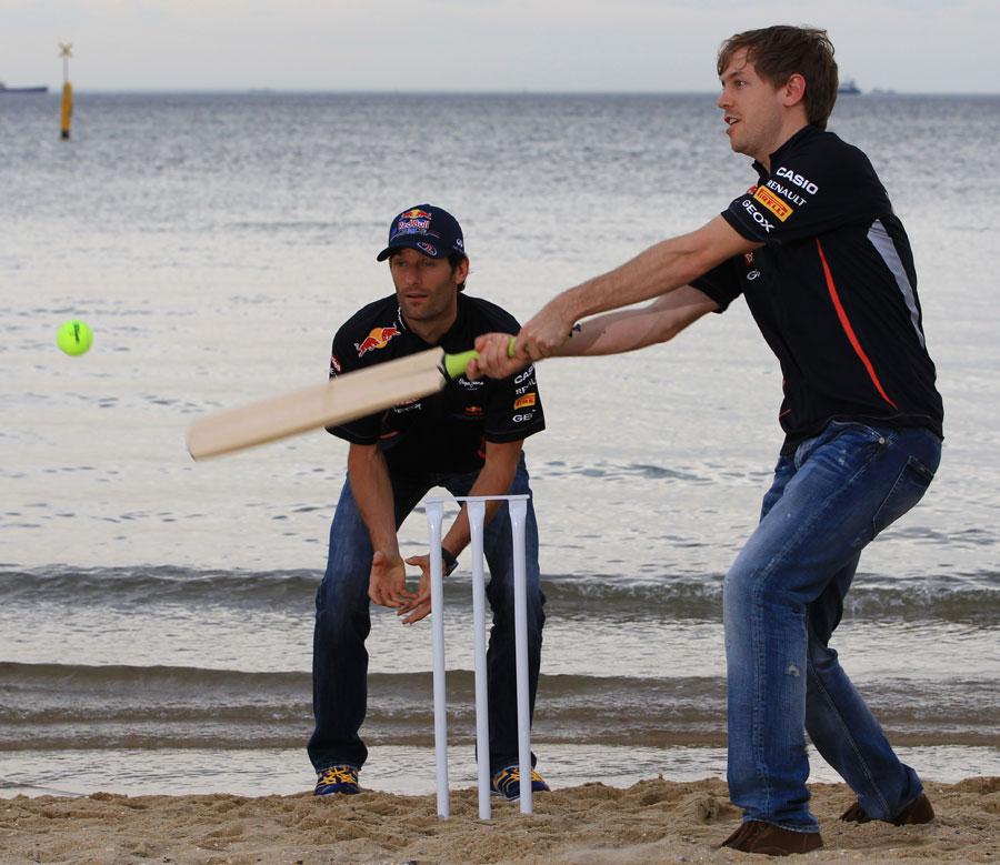 Sebastian Vettel and Mark Webber play cricket on St Kilda Beach