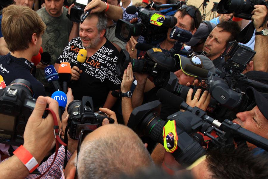 The media scrum around Sebastian Vettel on St Kilda Beach