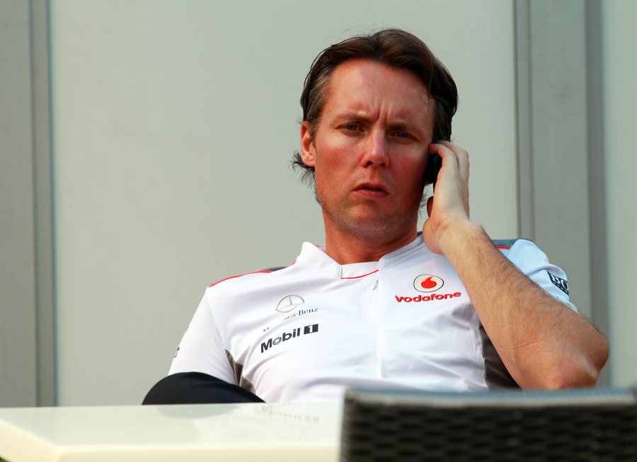 Sam Michael talks on the phone ahead of his first race in an official McLaren capacity