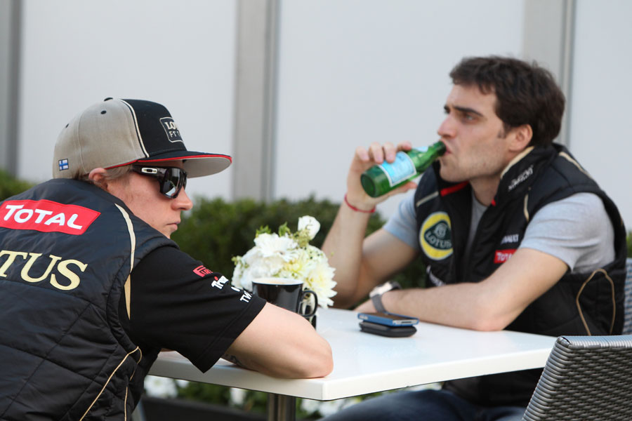 Kimi Raikkonen and Lotus reserve driver Jerome d'Ambrosio share a table in the paddock