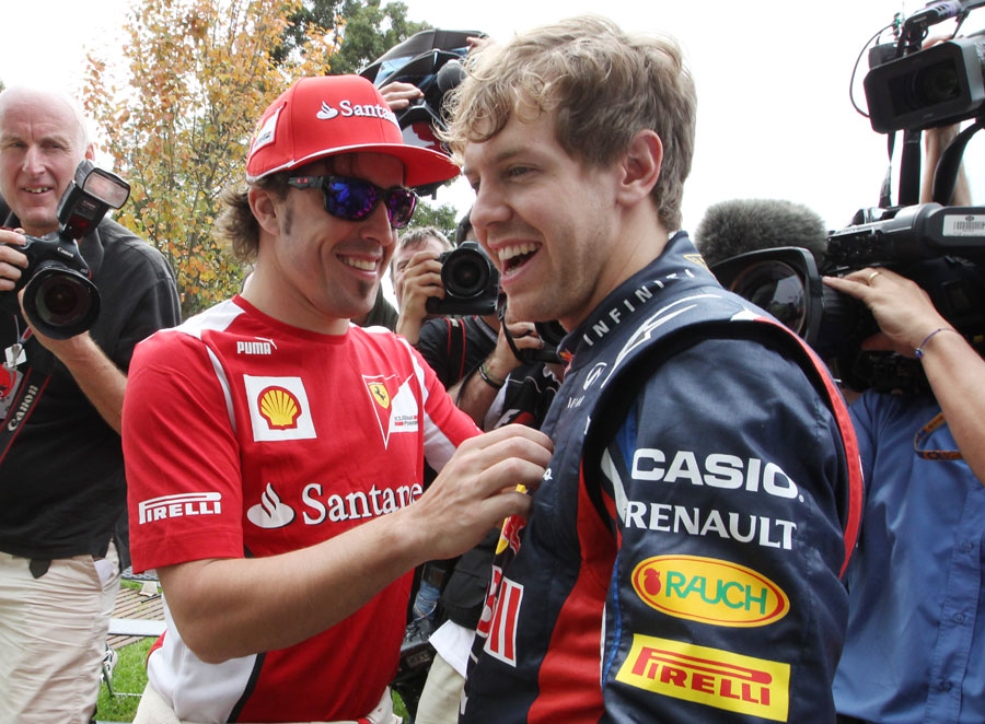 Fernando Alonso jokes with Sebastian Vettel in the Albert Park paddock