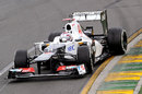 Kamui Kobayashi holds a big slide in his Sauber