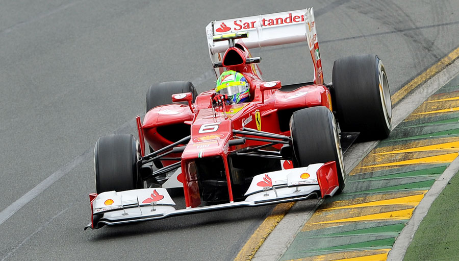 Felipe Massa catches a slide coming out of turn one