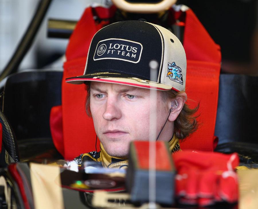 Kimi Raikkonen in the cockpit of his Lotus