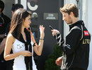 Romain Grosjean in the paddock with his girlfriend and TV presenter Marion Jolles
