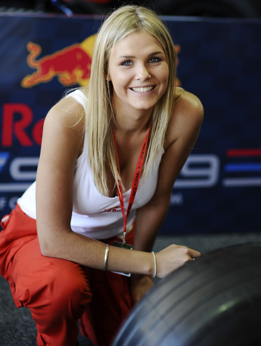 A Red Bull promo girl poses for a photo